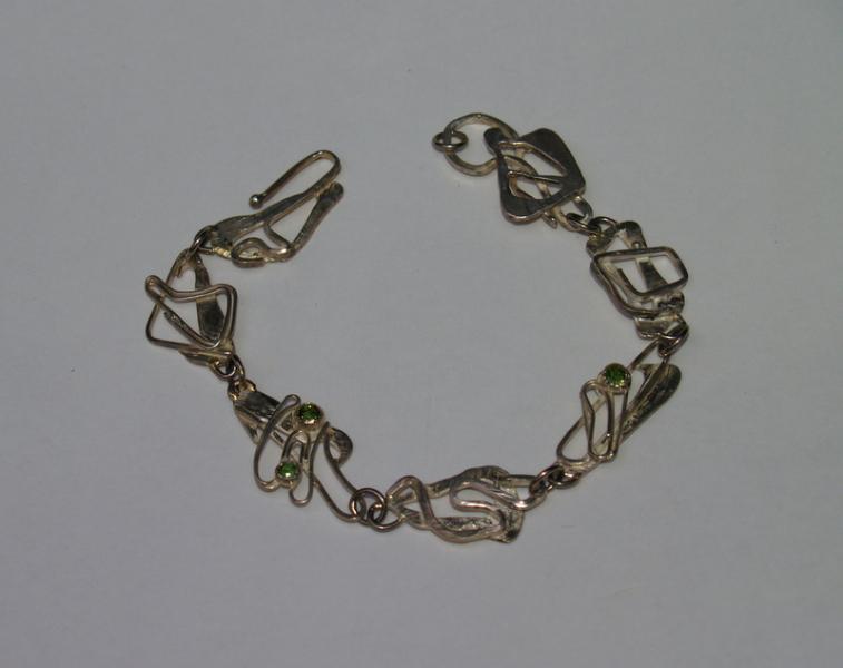 Hand/Armschmuck, Silber, Edelstein.